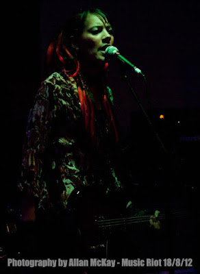 Anna-Christina from Lilygun singing on stage photo