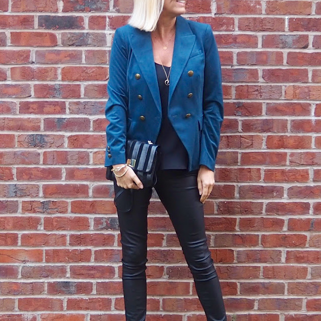 teal blazer and a column of black
