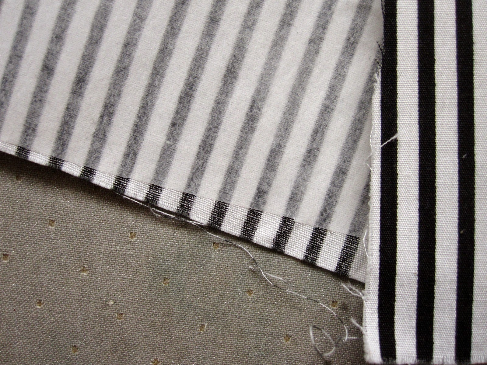 Piece of black and white striped fabric, backed with fusible webbing.