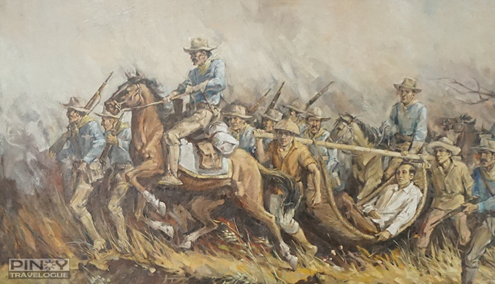 Painting that portrays Aguinaldo's men carrying Mabini on their way to Kawit