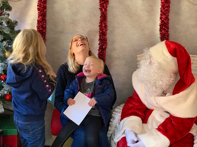 A family laughing in Santa's grotto