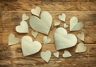 heart shaped paper cut design in wooden background
