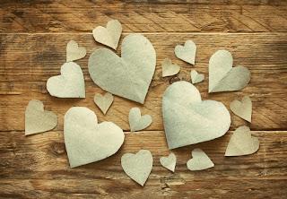 heart-shaped-paper-cuts-beautiful-design-wooden-background.jpg