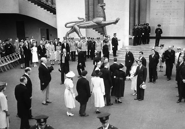 Presentations are made to Britain's King George VI and Queen Elizabeth in the British Pavilion, during their visit to the fair in New York, on June 19, 1939.