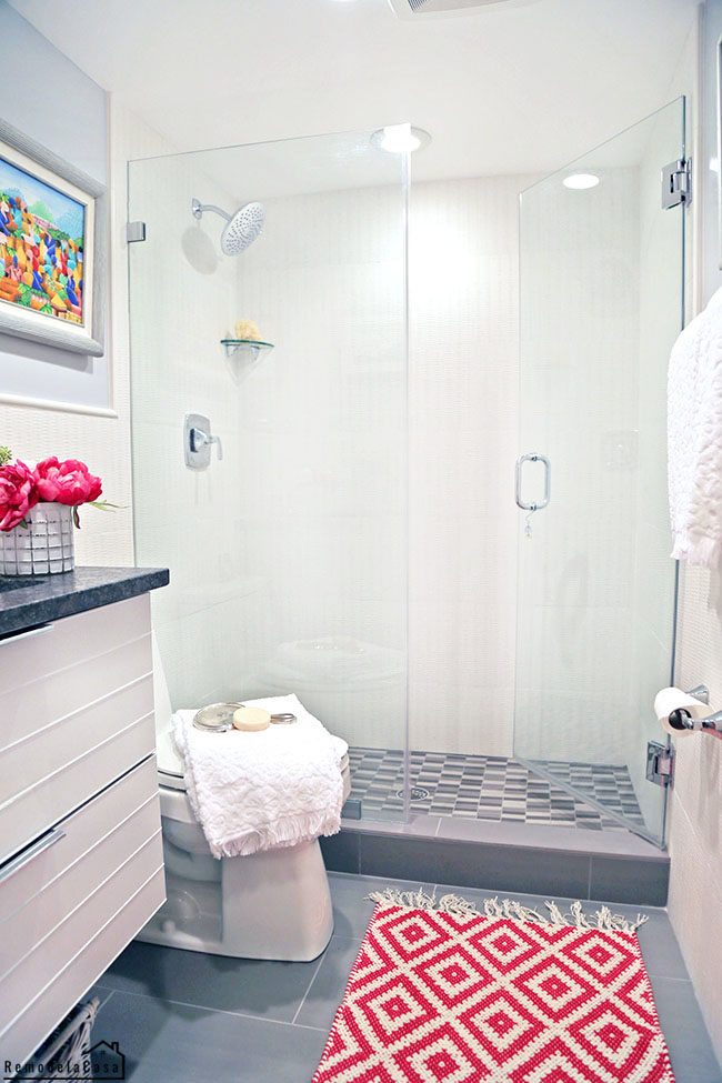 white and gray bathroom with fuchsia accents