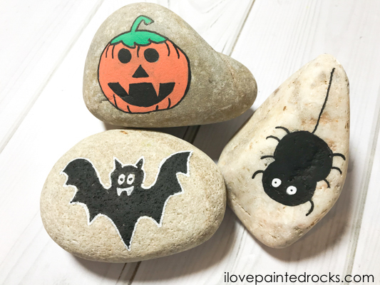 Here is a tutorial for painting halloween rocks a spider, pumpkin and bat