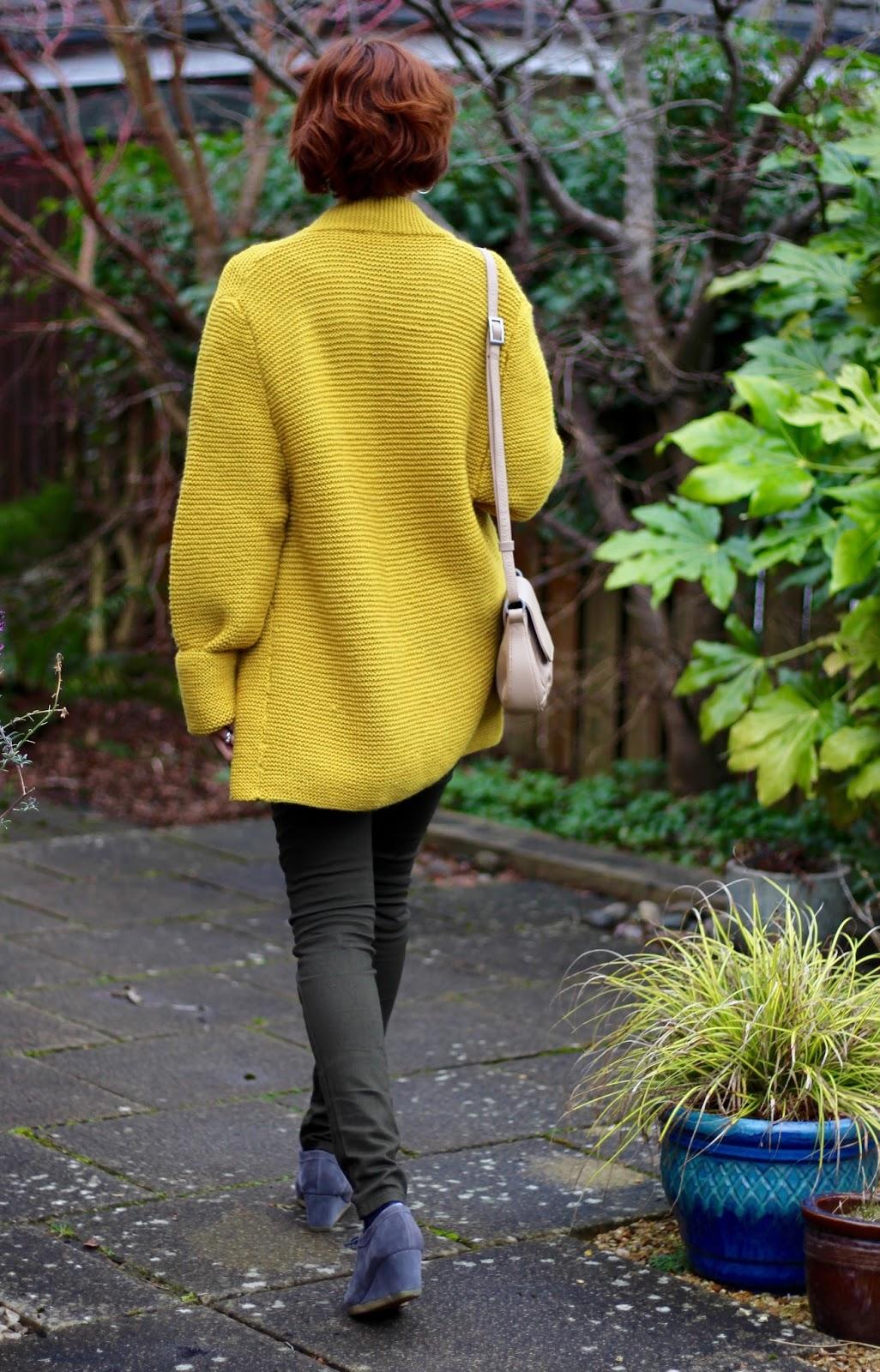 Oversized Mustard Handknitted Cardigan, Khaki Biker Jeans & Grey Clarks Wallabees | Fake Fabulous