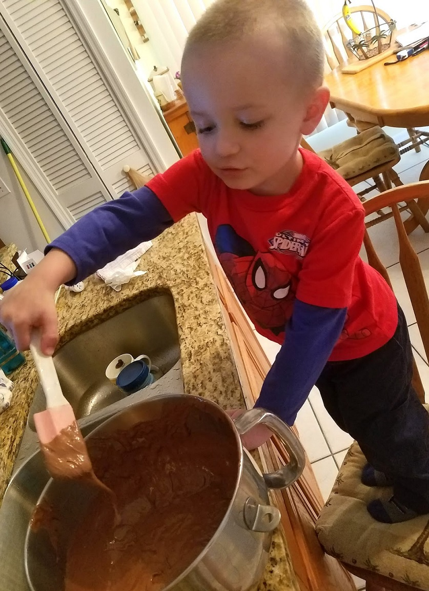 Antonio my grandson making the  cake batter