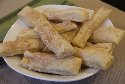 plate of churros made from puff pastry dough