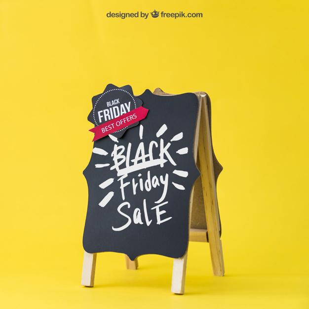Black friday mockup with decorative board Free Psd