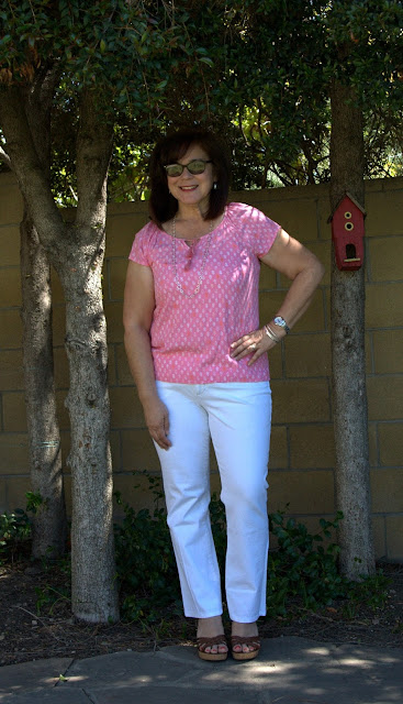 white jeans and pink top