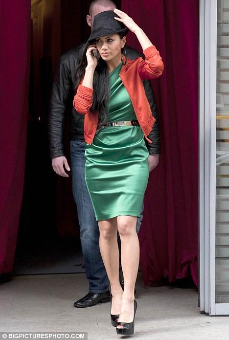 Bright Nicole Scherzinger Leaves Her Paris Hotel Yesterday In A Bright Green Dress And Clashing Orange Cardigan