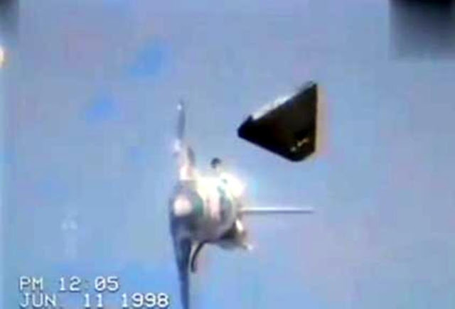 Large Black Pyramid UFO stalking the ISS and Shuttle in space.