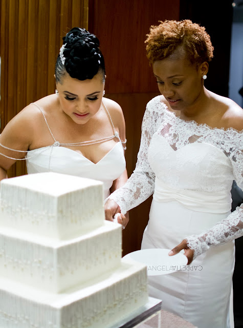 Deep South Brides at 21C Museum Hotel  shot on location by fine art wedding photographer Angela Cappetta cake cutting