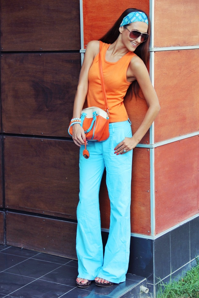 orange knitted top turquoise linen pants outfit