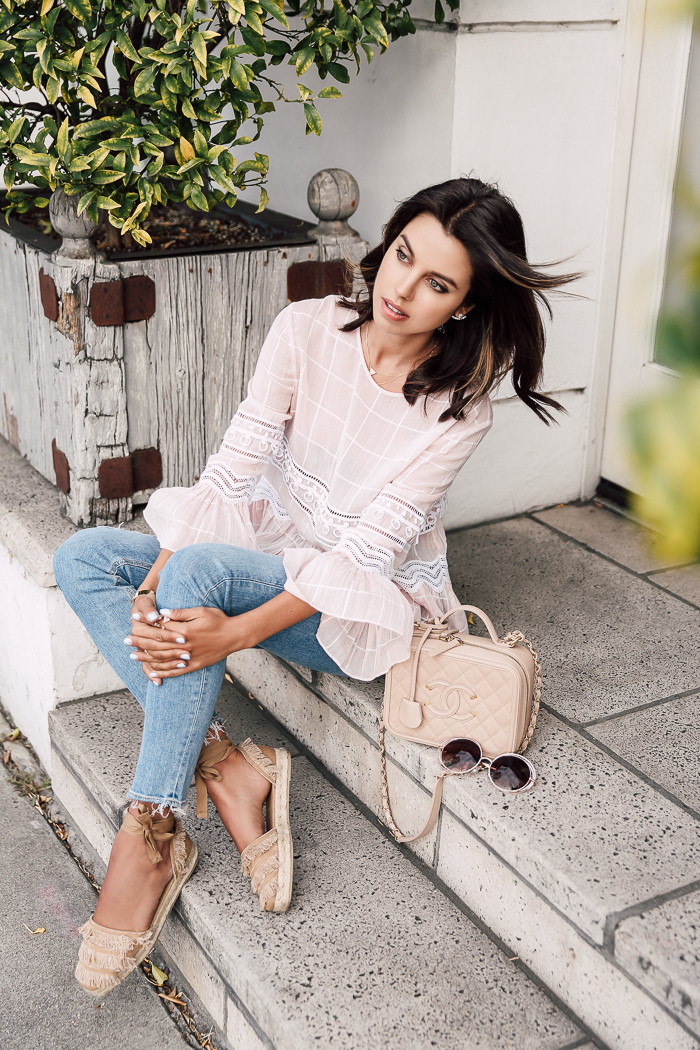 341a3930fdf Floaty lace fabrics can make the ultimate summer blouses! Annabelle Fleur  is looking ultra feminine in this bell sleeved lace blouse