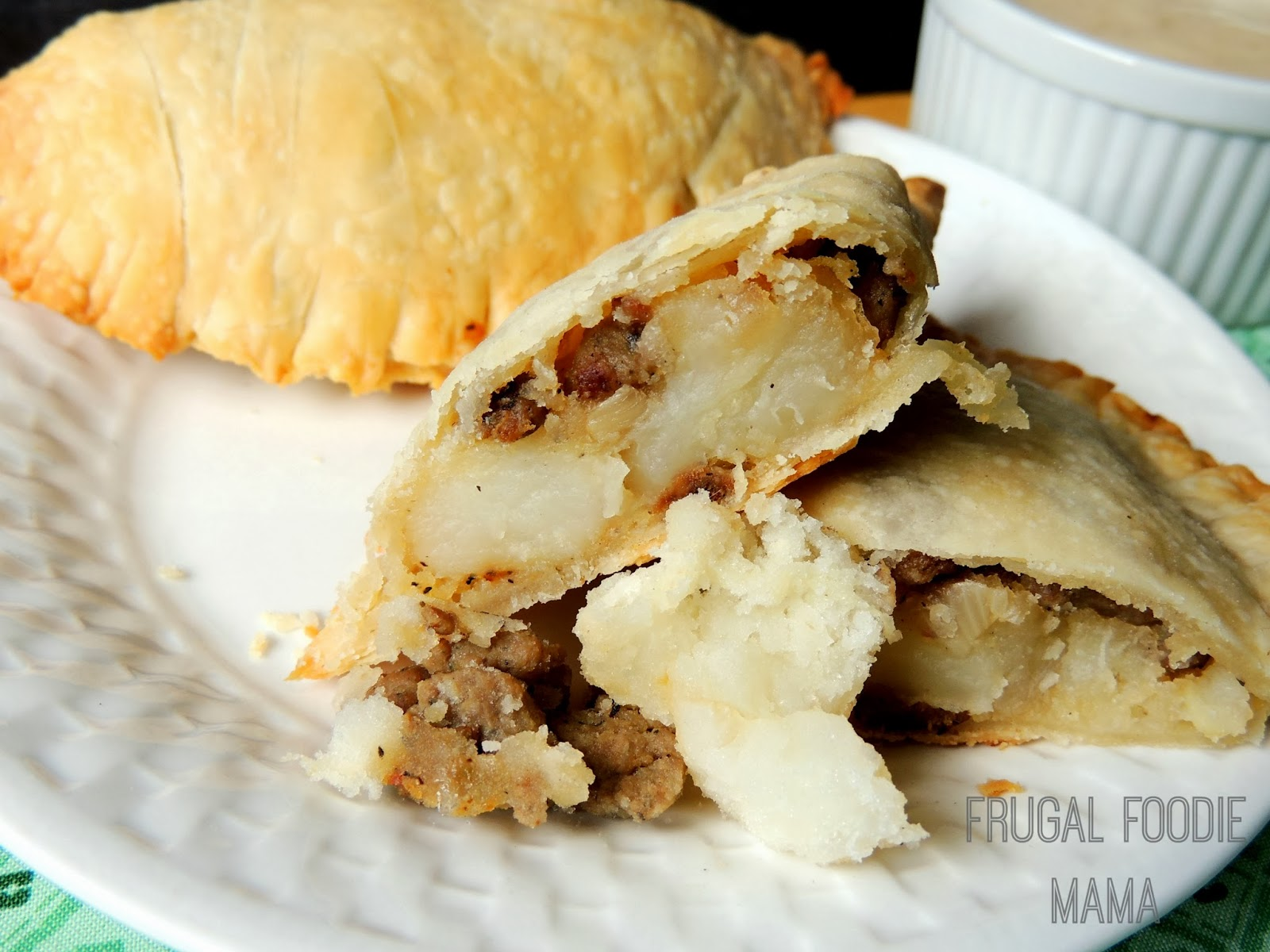 These Easy Turkey Sausage Irish Pasties have a hearty, tasty filling wrapped in a light, flaky crust and served with a quick and creamy homemade gravy.
