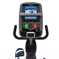Console with Blue backlit display on an exercise bike