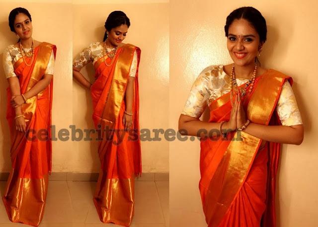 Sreemukhi Plain Silk Saree in Orange