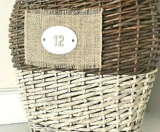 basket with burlap bottom and metal tag