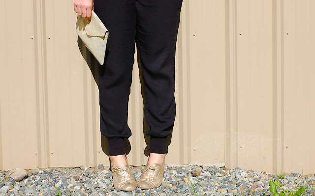 Smythe tuxedo blazer, Vince silk jogger pants, French Connection silk tank, gold Gap clutch and gold brogues.