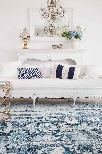 white tufted french sofa