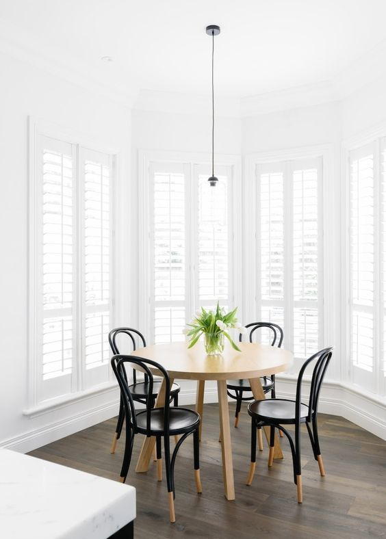 Beautiful breakfast room with white plantation shutters