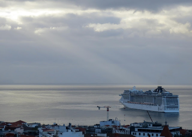 a shaft of sunlight illuminates the MSC Preziosa