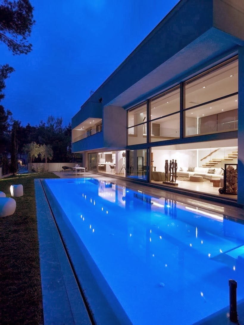 Swimming pool in Modern Mansion in Dionysos at night