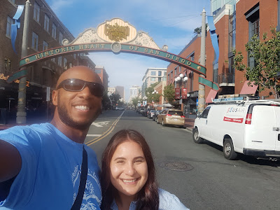 Tim and Ericka standing in front of the Gas Lamp District