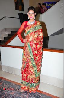 Model Sharon Fernandes Stills in Red Saree at Trendz Exhibition Launch  0051.JPG