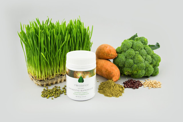 InLiven Tub with yam, broccoli and grass in the background. With InLiven Powder in the foreground.