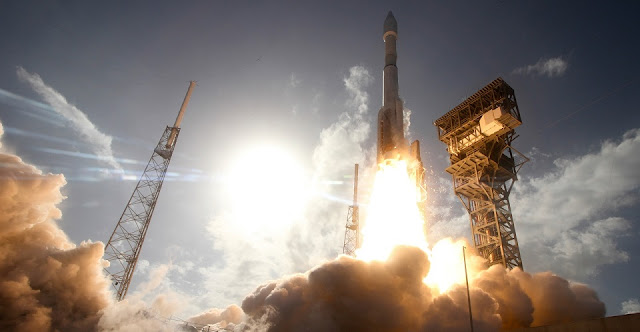 The Atlas V 431 with EchoStar XIX ascends toward the sky. Photo Credit: ULA