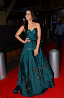 Raashi Khanna in Dark Green Sleeveless Strapless Deep neck Gown at 64th Jio Filmfare Awards South ~  Exclusive 037.JPG