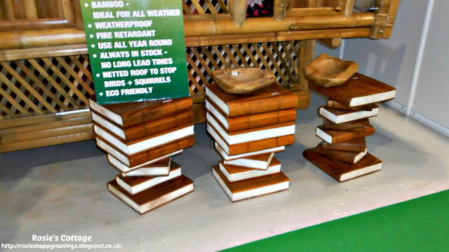 Wooden side tables in the shape of book stacks