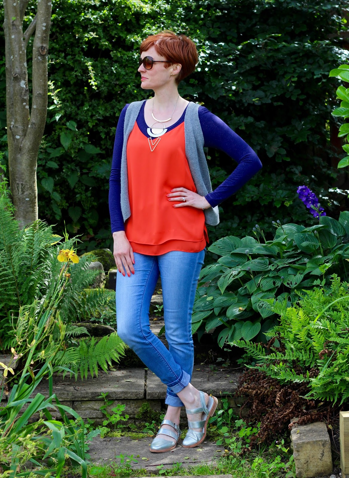 Fake Fabulous | Orange camisole, Navy undertop, grey waistcoat, skinny light denim jeans and silver shoes.