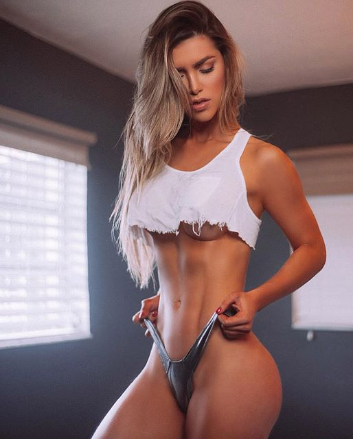 Muscular woman flexing biceps 4