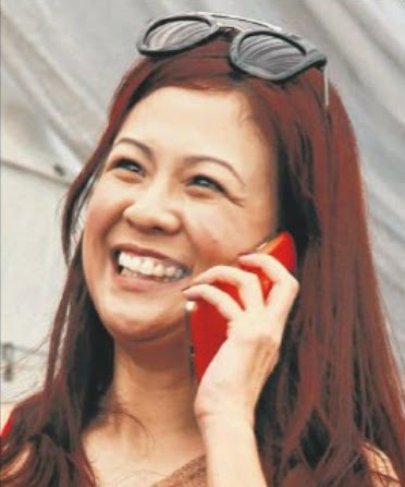 Madam Yeo got on her mobile phone and called her daughter, Natalie for help.