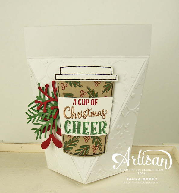 Pretty Pines dies, Merry Music DSP with Merry Cafe stamp set from Stampin' Up! That is one merry mix! This self-closing box is perfect for stocking stuffers and gifts for co-workers! It will hold all kinds of goodies including a gift card, chocolates, jewelry, and 1 ounce of loose leaf tea in a baggie!~Tanya Boser for the Artisan Design Team