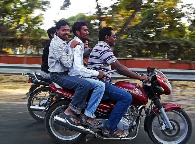 three men on bike