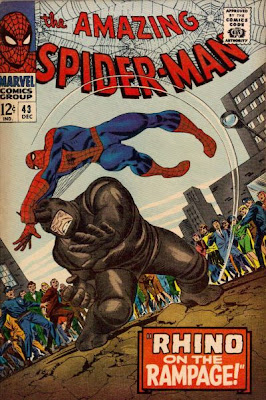 Amazing Spider-Man #43, Spidey holds onto the horn of the Rhino as a group of onlookers watch in trepidation, John Romita cover