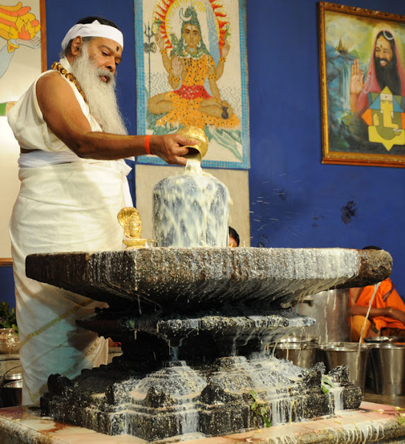 Shivalingam is given a special bath with milk