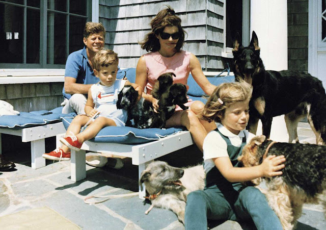 In this photo provided by the White House, President Kennedy, first lady Jacqueline Kennedy and their children, Caroline and John Jr., with the family dogs at their Hyannis Port, Massachusetts, home, on August 14, 1963.