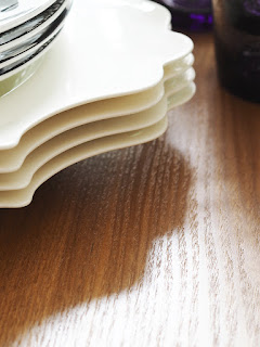 My Summer Dining Room - French For Pineapple Blog - close up of edge of scalloped plates on round wooden table