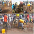 Aggrieved Nigerians storm the highways with gallons of water to wash the road Buhari passed during his Kano visit