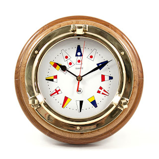 https://bellclocks.com/collections/bey-berk-international/products/nautical-flag-brass-porthole-clock-on-oak-wood-bey-berk-sq517