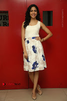 Actress Ritu Varma Stills in White Floral Short Dress at Kesava Movie Success Meet .COM 0168.JPG
