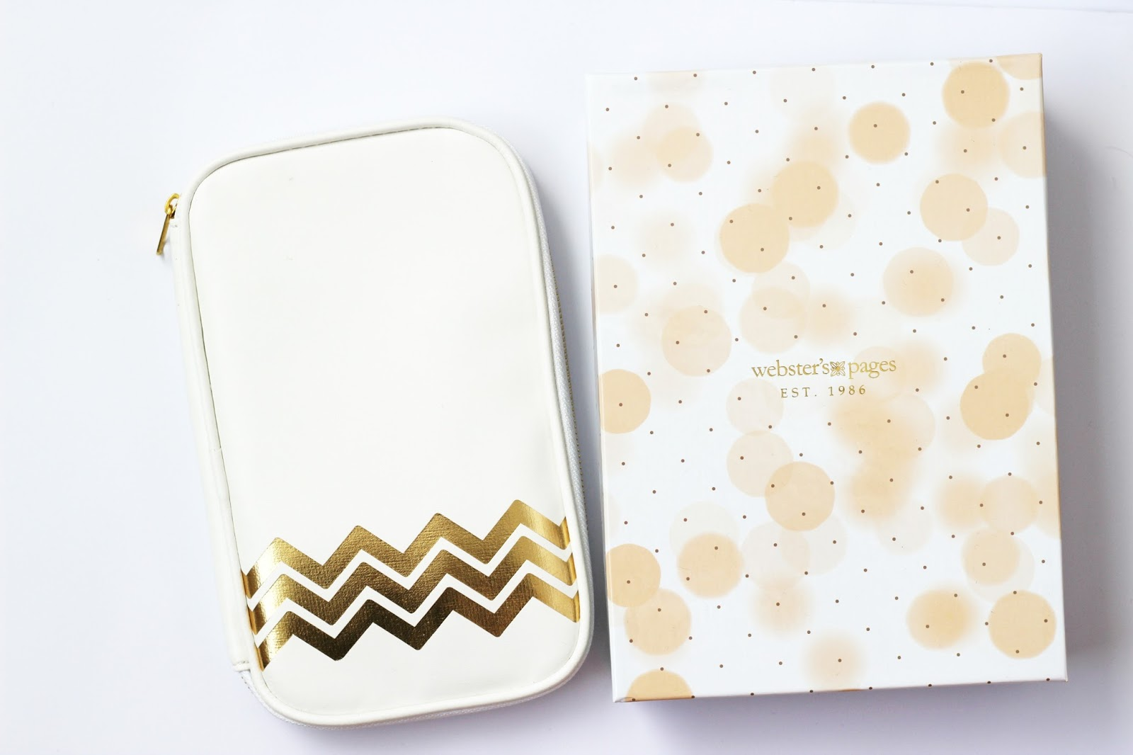 white and gold websters folio