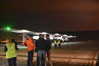 Ground crew taxiing the Solar Impulse 2 onto the runway at Moffett Field, Mountain View, California