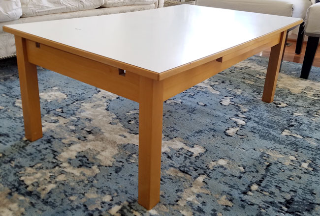 golden and white coffee table on blue foggy medallion rug